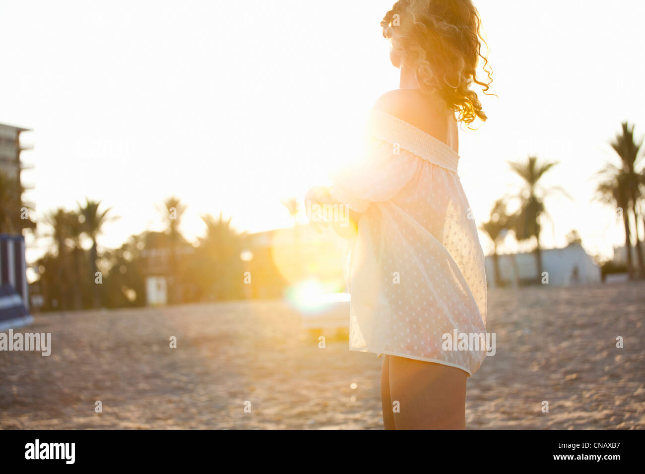 Woman wearing cover up on beach - Stock Image