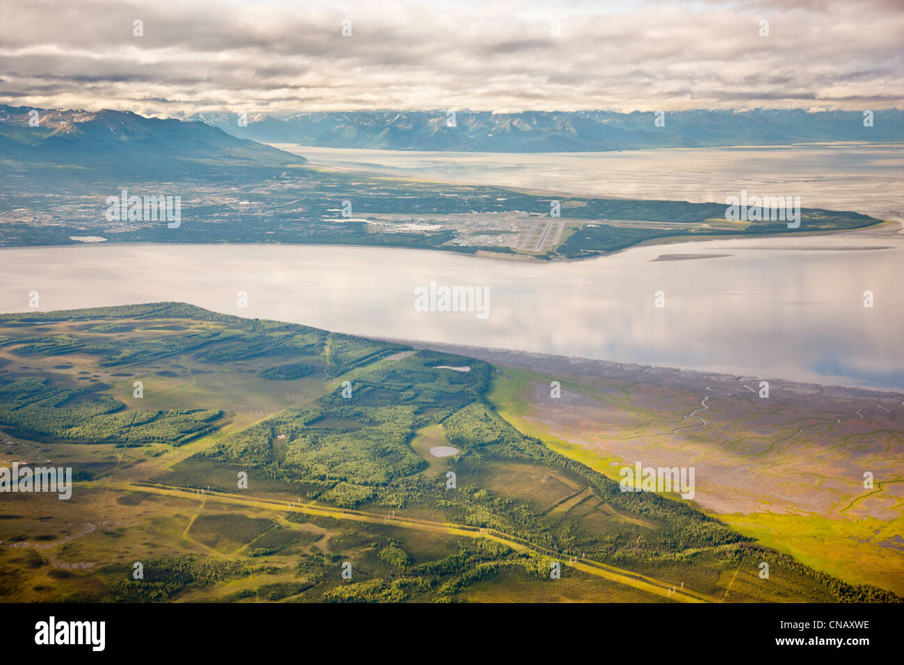 Aerial view of Knik Arm and the Anchorage bowl from the above the Susitna Flats State Game Refuge, Southcentral - Stock Image