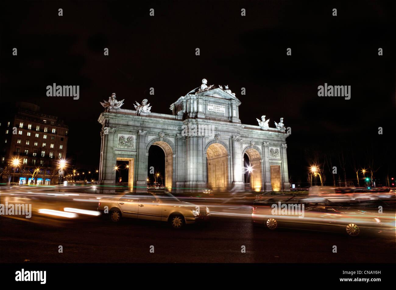 Puerta de Alcala lit up at night - Stock Image