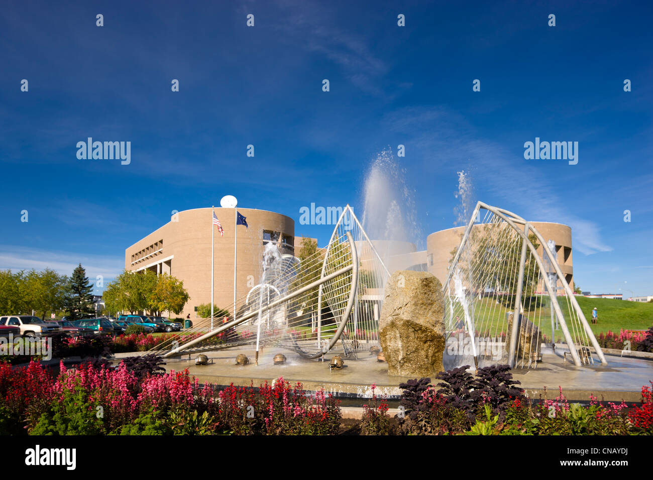 Loussac library and Carl Nesjar ice fountain in Midtown Anchorage, Southcentral Alaska, Anchorage, Summer - Stock Image