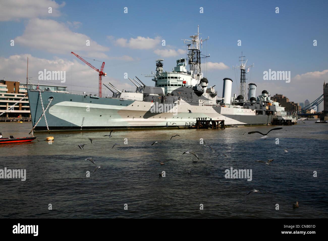 HMS Belfast moored on the River Thames near London Bridge, London, UK - Stock Image