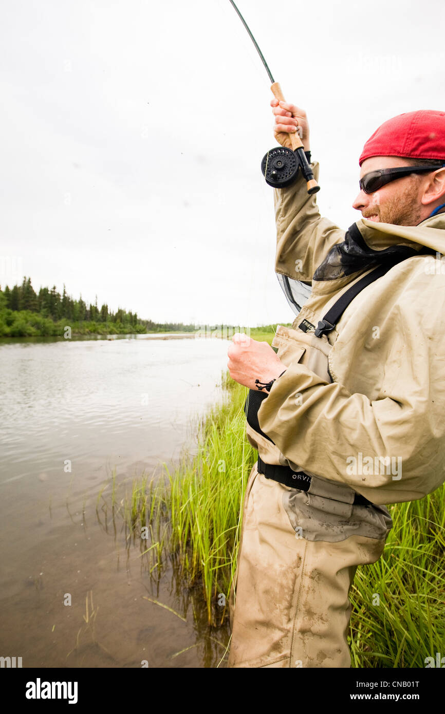 Fly fisherman fishing for salmon on the Mulchatna River in the Bristol Bay area, Southwest Alaska, Summer Stock Photo