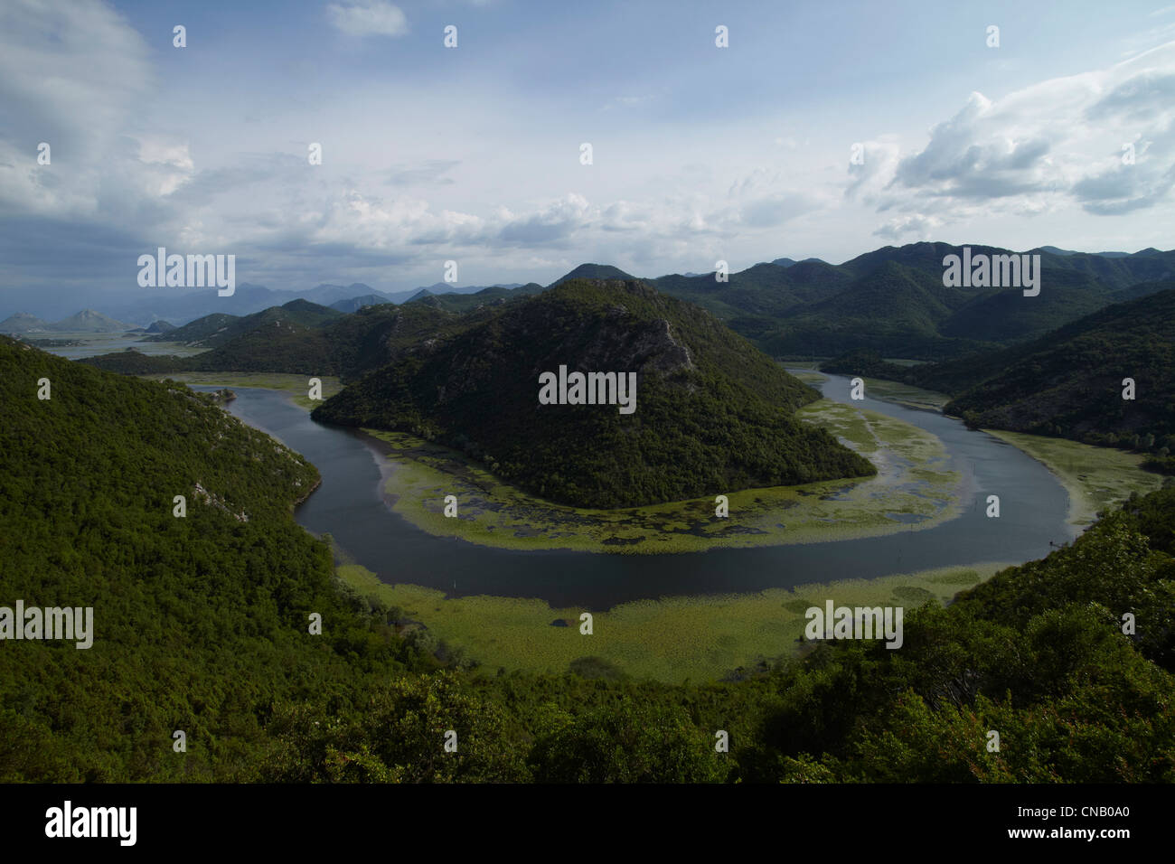 Meandering river in valley - Stock Image