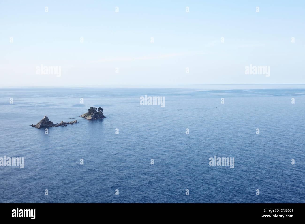Rocks in still waters - Stock Image