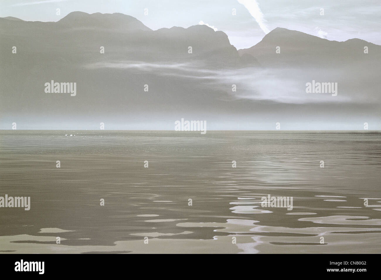 Still water on sandy beach - Stock Image