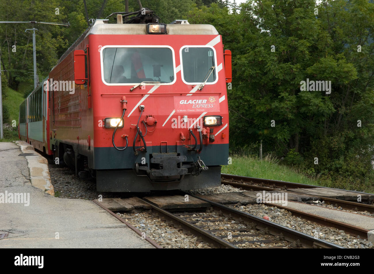 Matterhorn Gotthard Bahn Glacier Express train in Bellwald station in Canton of Valais in Switzerland - Stock Image