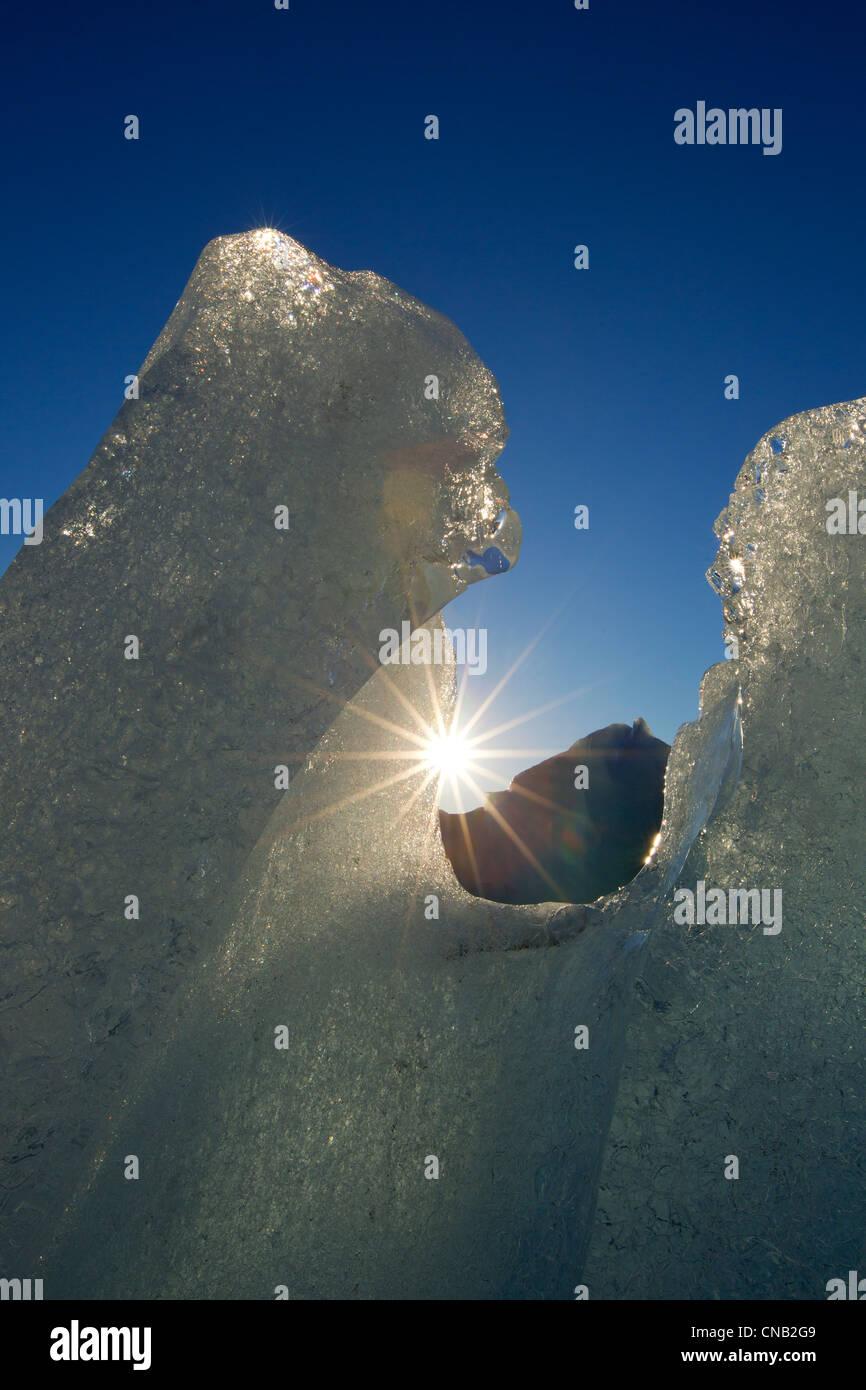 Close up of icebergs with sun peeking through, Mendenhall Lake, Tongass National Forest, Southeast Alaska, Winter - Stock Image