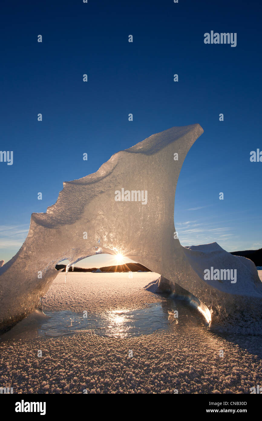View of icebergs formations frozen in Mendenhall Lake with sun peeking through, Tongass National Forest, Alaska, - Stock Image