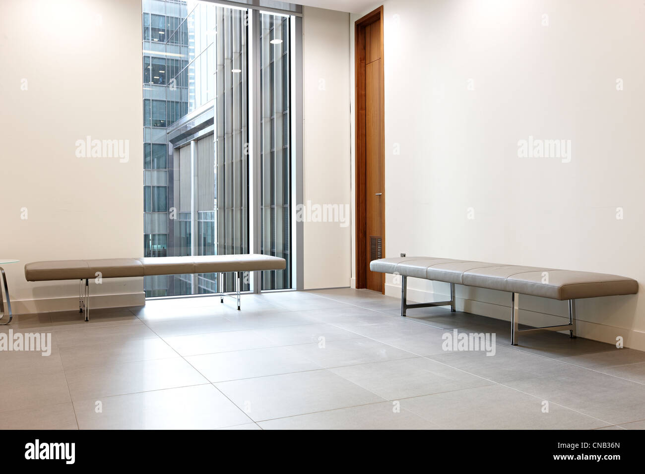 bank reception benches window city waiting room - Stock Image