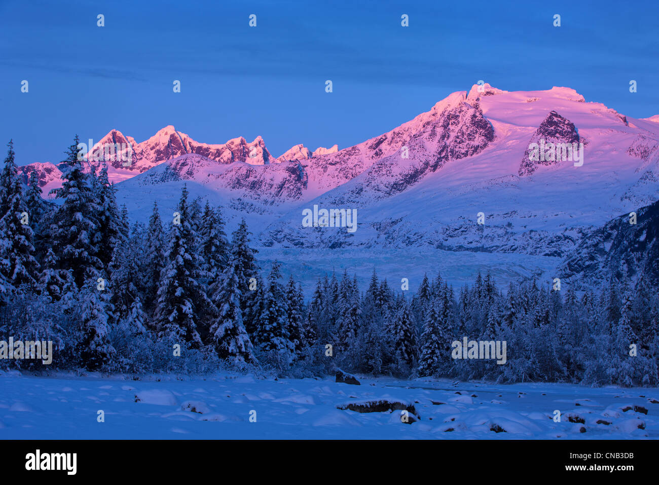 Panoramic view of alpenglow on the Coast Mountains above Mendenhall Glacier, Tongass National Forest, Southeast Stock Photo