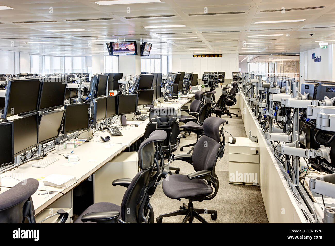 trading floor bank untidy mess sacked fired close down - Stock Image