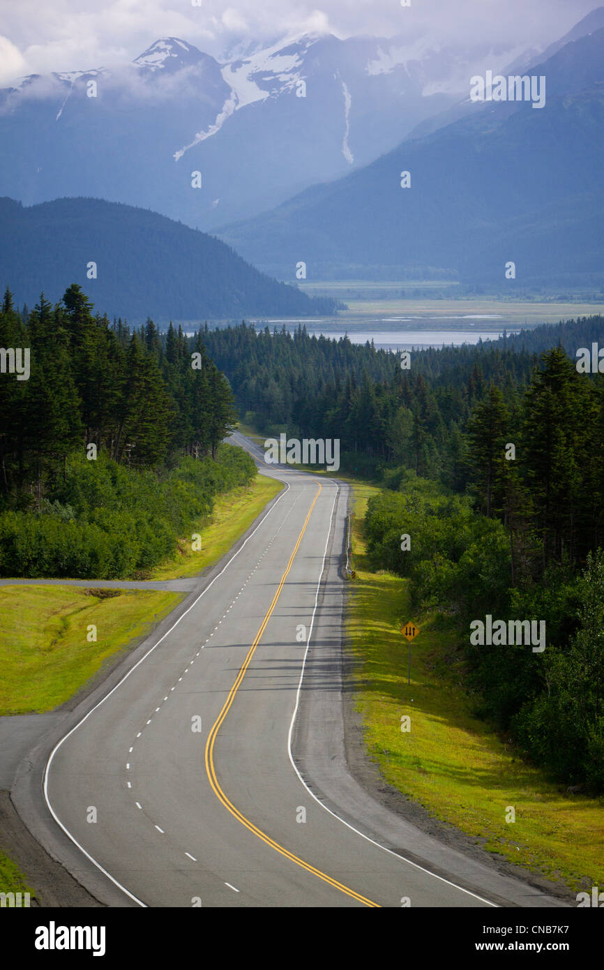 Scenic Seward Highway with the Chugach Mountains in the background, Kenai Penninsula, Southcentral Alaska, Summer - Stock Image