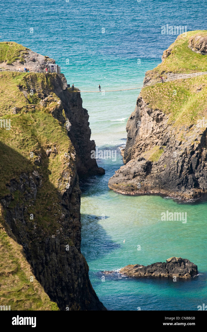 United Kingdom, Northern Ireland, Antrim county, Ballintoy, coast of Antrim, bridge of Carrick-a-rede Island - Stock Image