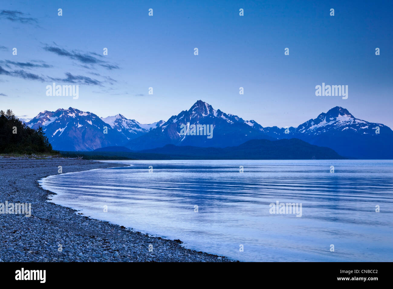 View of Mount Wright seen from Goose Cove at dusk, Glacier Bay National Park & Preserve, Southeast Alaska, Summer - Stock Image