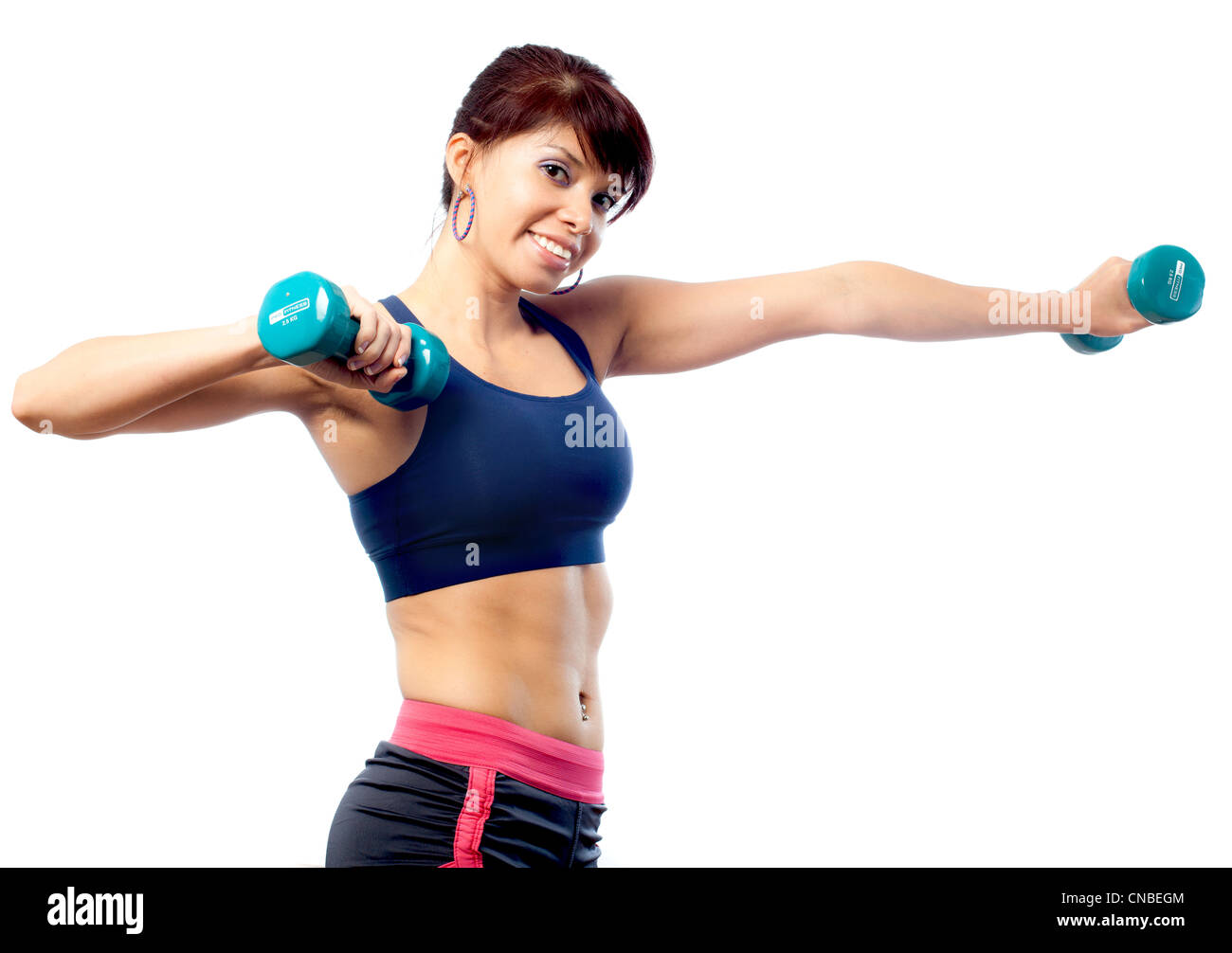 Female fitness trainer with dumbbells - Stock Image