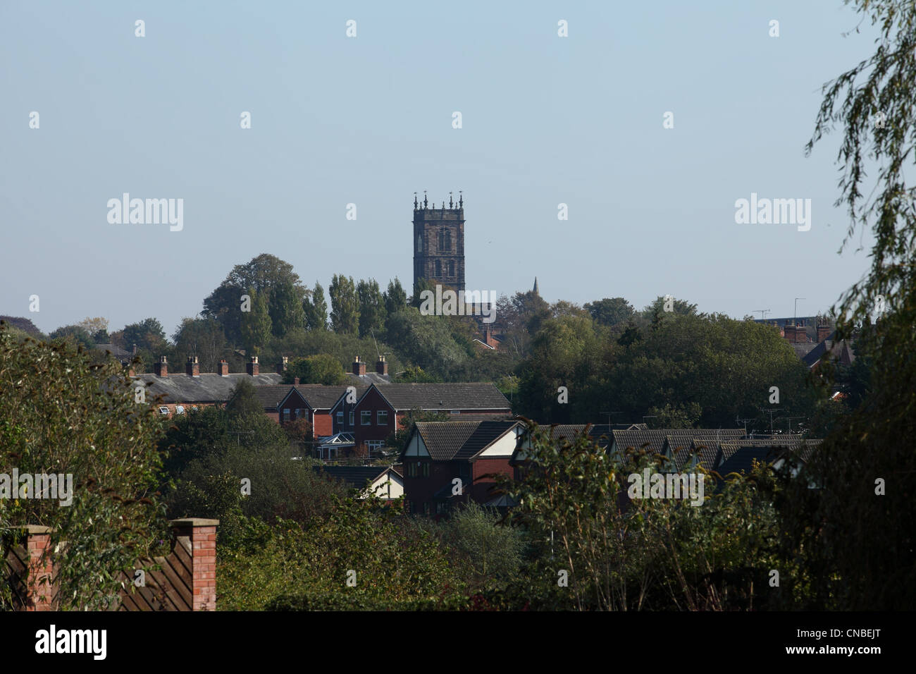 Townscape of Whitchurch, Shropshire, with the tower of St Alkmunds Parish church on the skyline - Stock Image