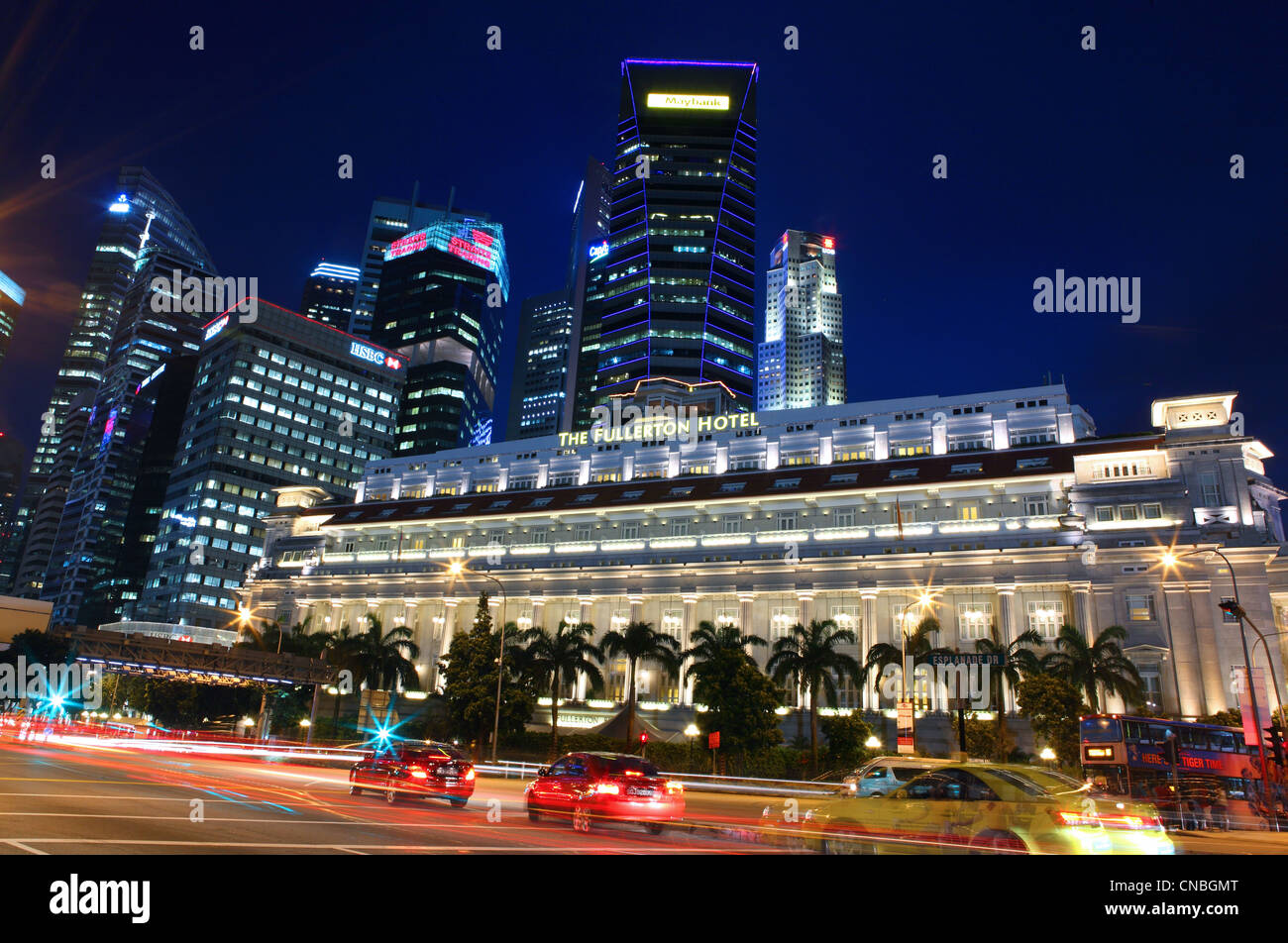 The Fullerton Hotel on Esplanade Drive and Singapore financial district high rise buildings. Singapore, Southeast - Stock Image