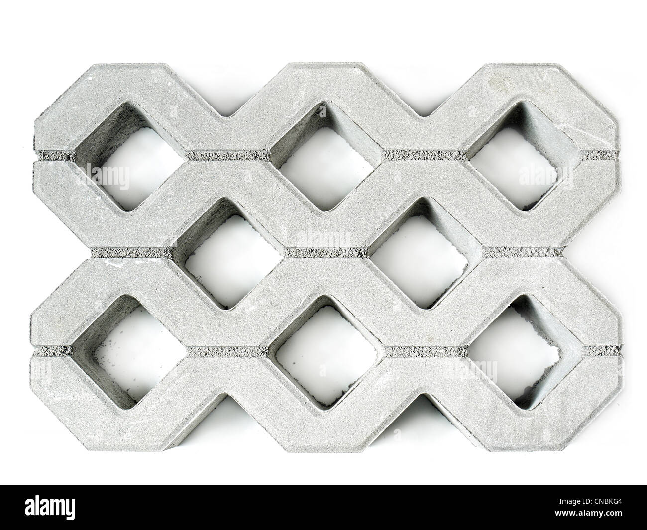 Concrete pavement block shot from above on white background - Stock Image