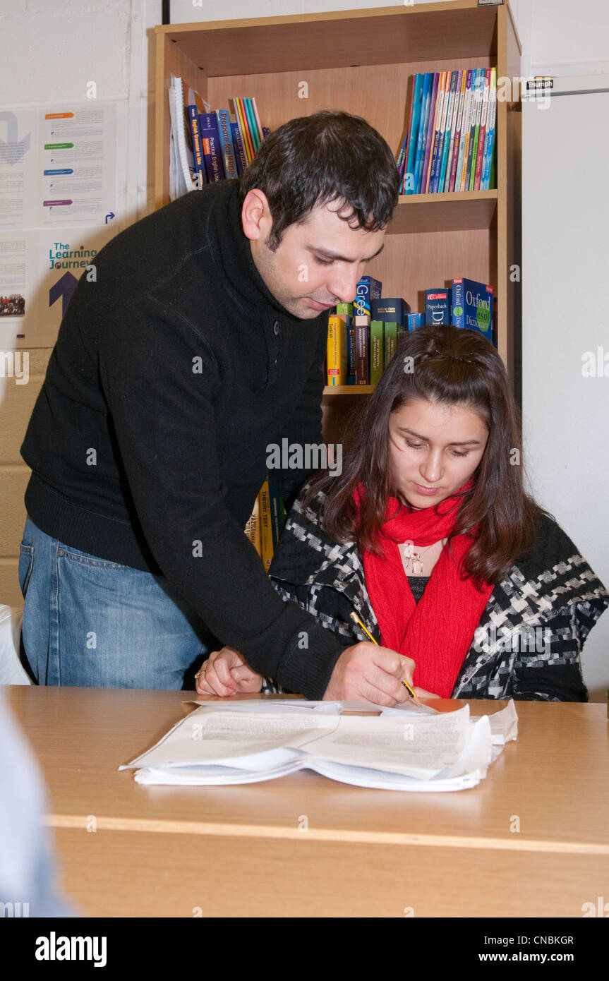 A class of non native English speakers learning basic literacy and numeracy skills - Stock Image