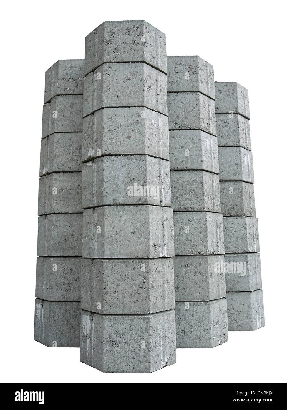 Pile of concrete pavement blocks isolated on white background - Stock Image