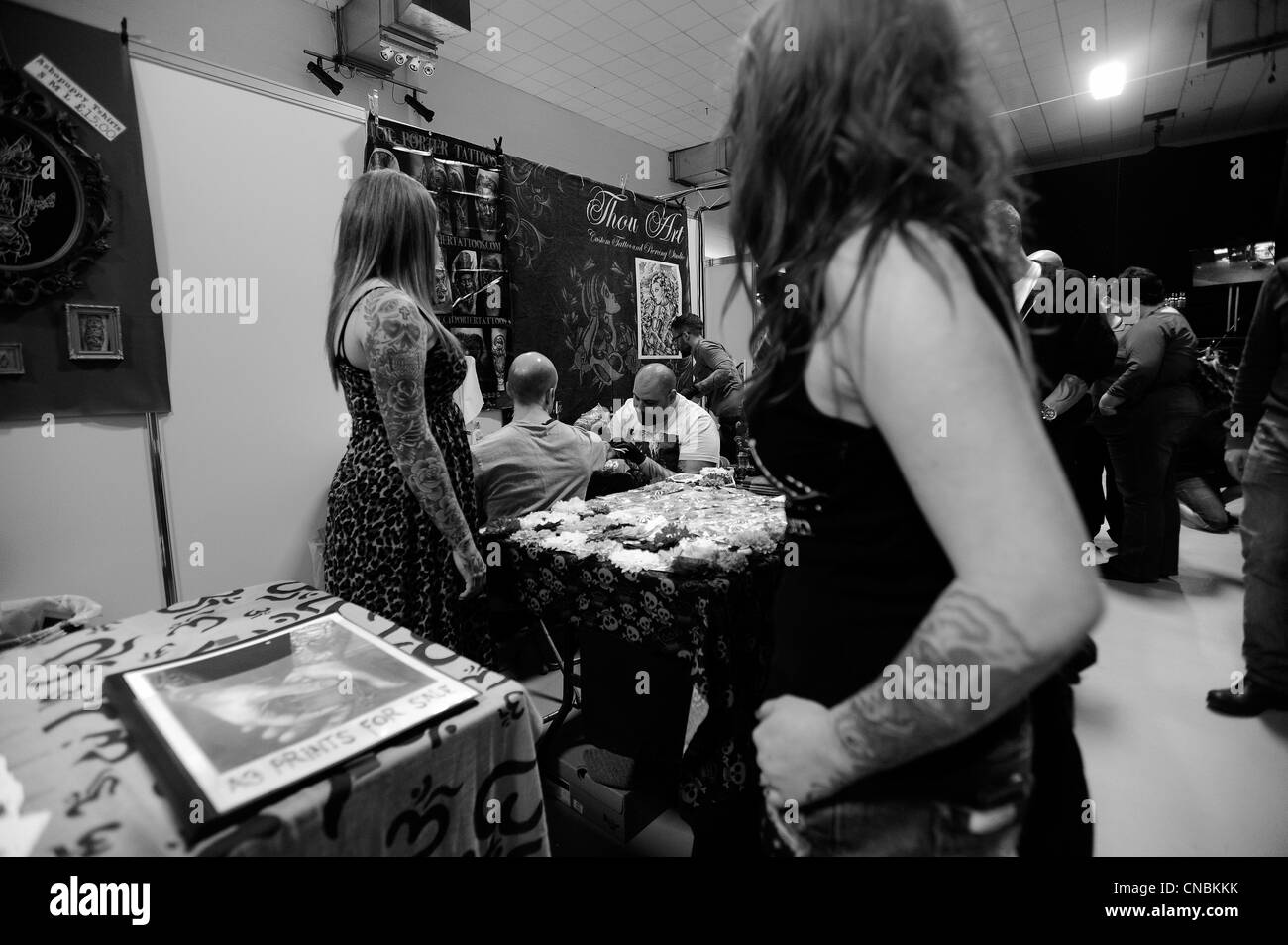 Tattooists from around the world work at The Edinburgh Tattoo Convention 2012 in Edinburgh, Scotland. Stock Photo