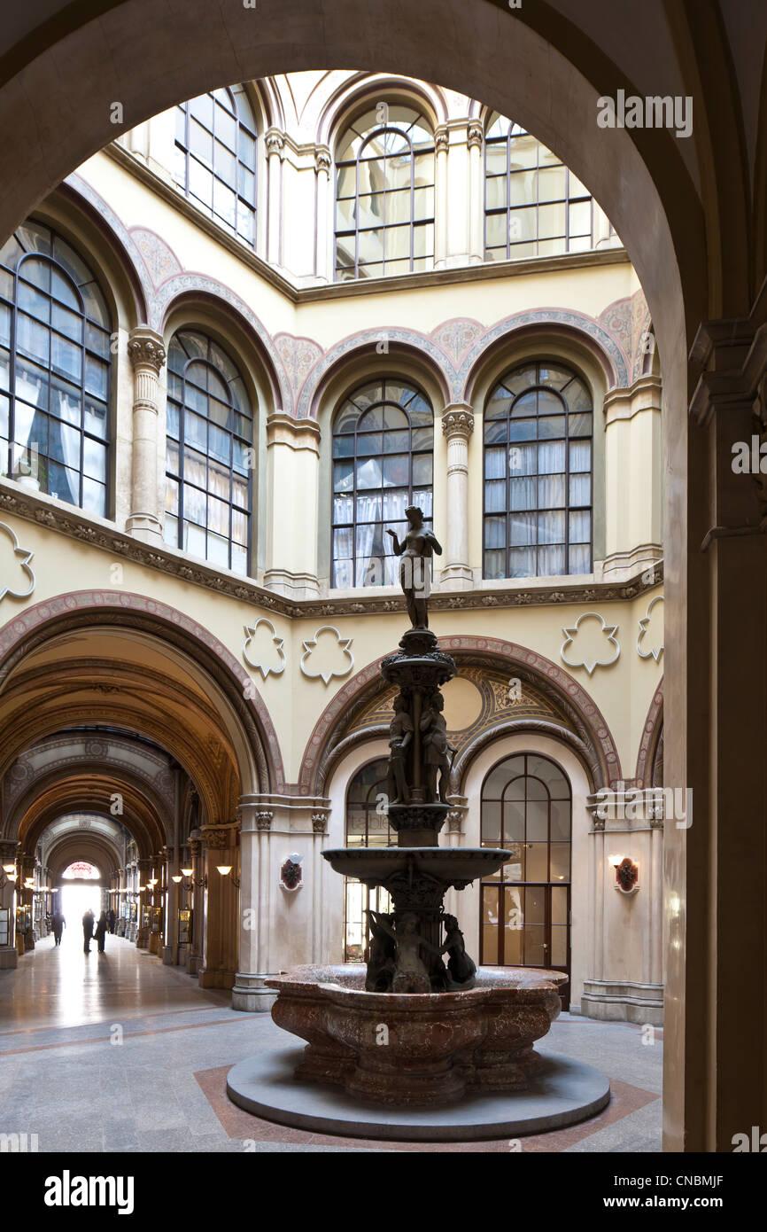 Austria, Vienna, Ferstel Palace, built in 1860 by architect Heinrich von Ferstel, bronze fountain of the Danube - Stock Image