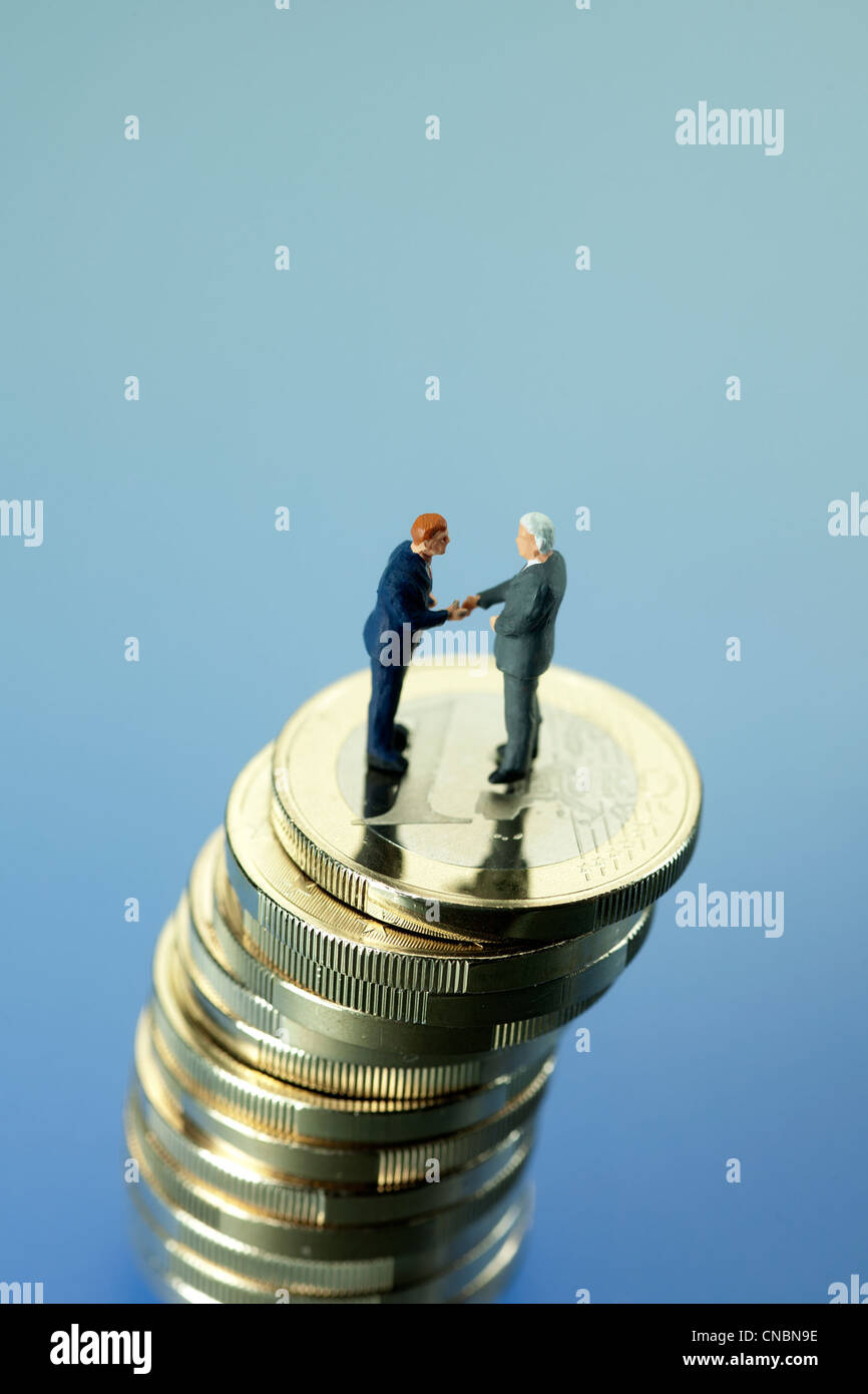Symbolic picture of a financial agreement - Stock Image