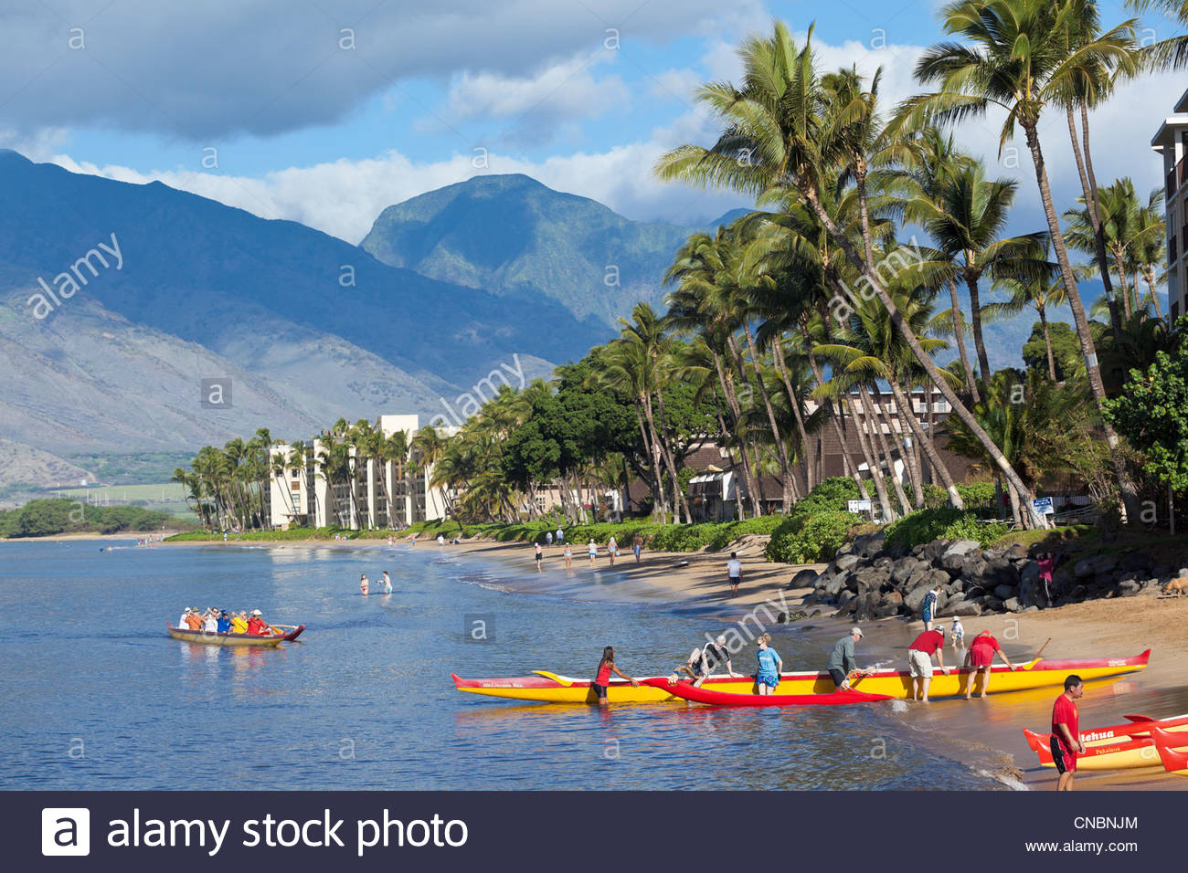 Outrigger canoes at Sugar Beach at the Kihei Canoe Club in Kihei on the island of Maui in the State of Hawaii USA - Stock Image
