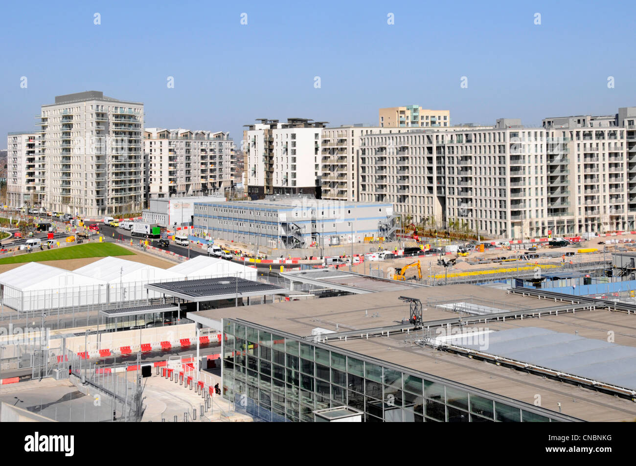 London 2012 Olympic athletes village building site with temporary site offices & Stratford International station - Stock Image