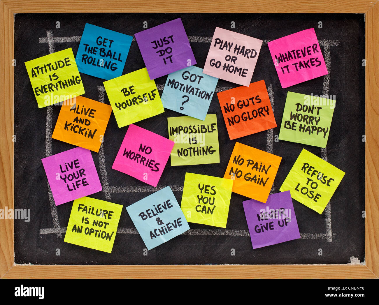 motivational slogans and phrases - colorful reminder notes on blackboard - Stock Image