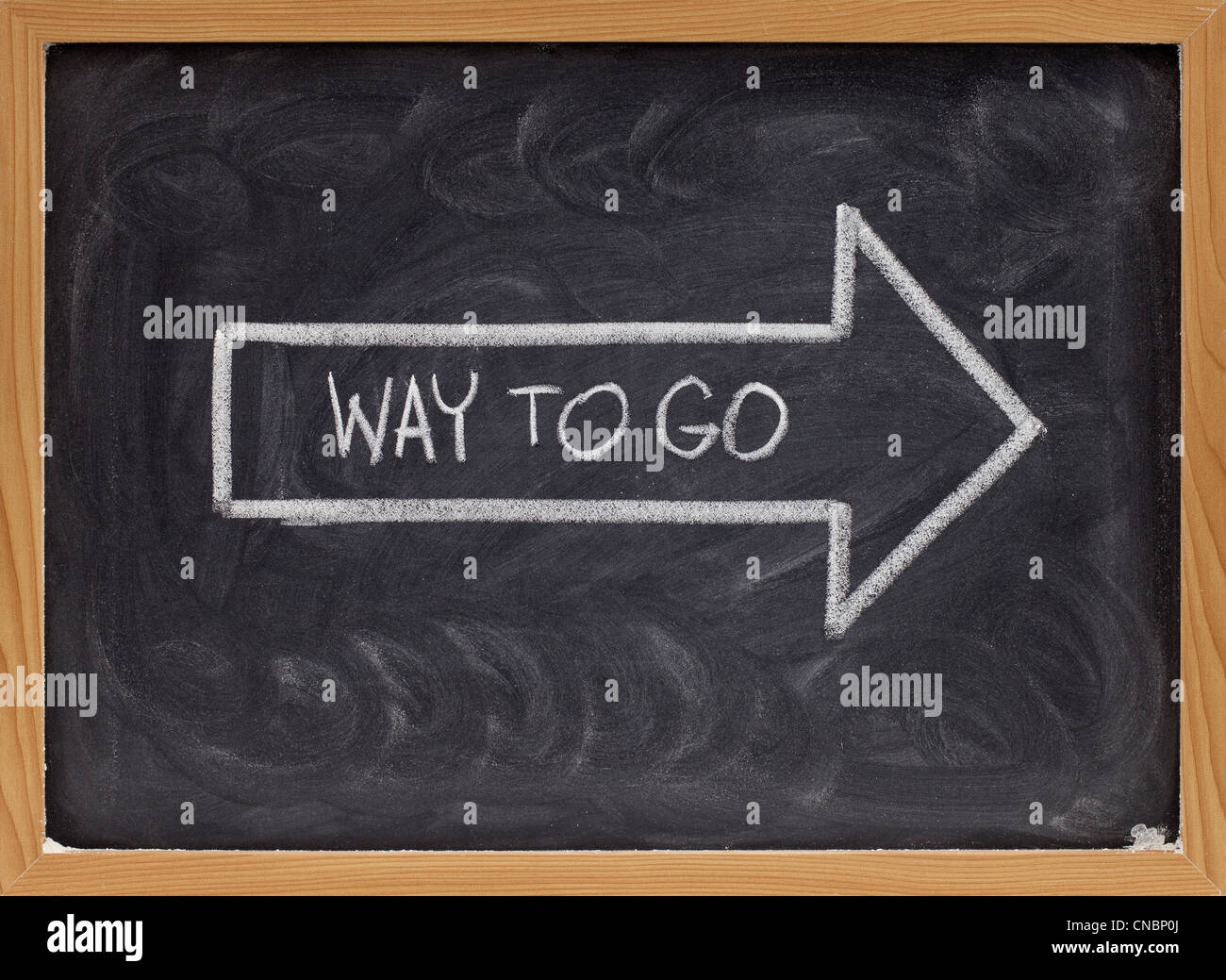 way to go complement handwritten with white chalk inside an arrow on blackboard Stock Photo