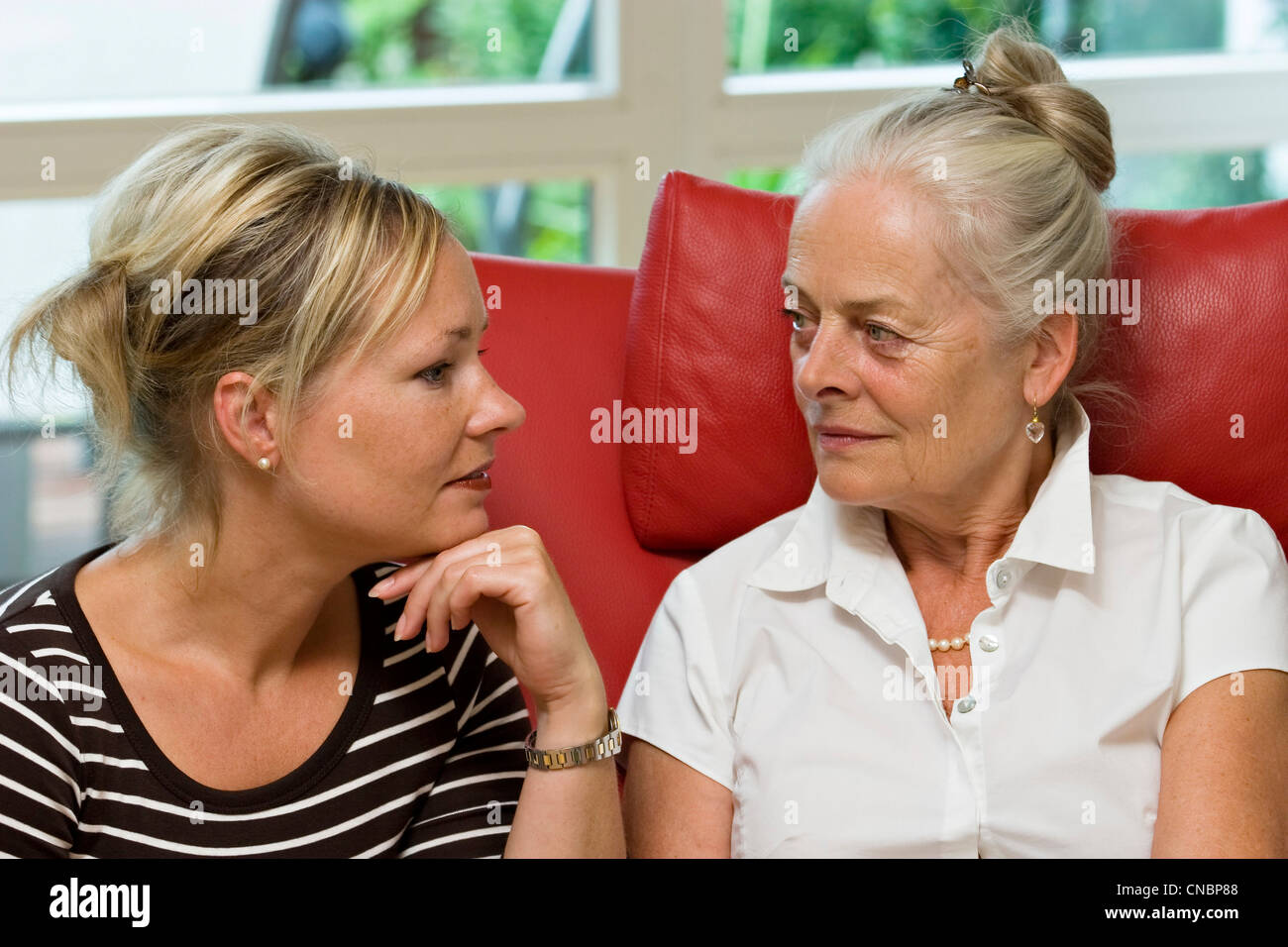 Eldery lady listening to her daughter Stock Photo
