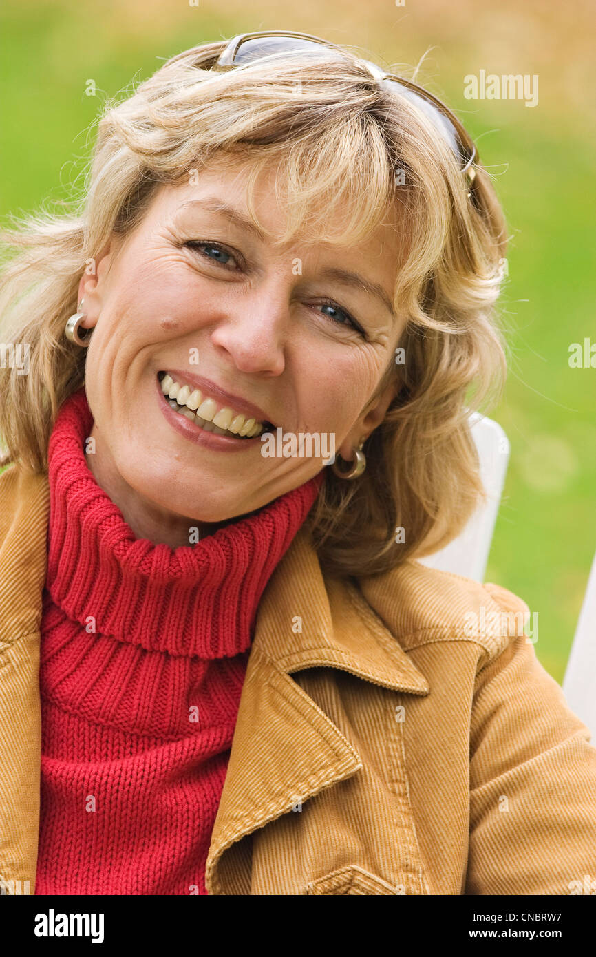 Portrait of a laughing woman - Stock Image