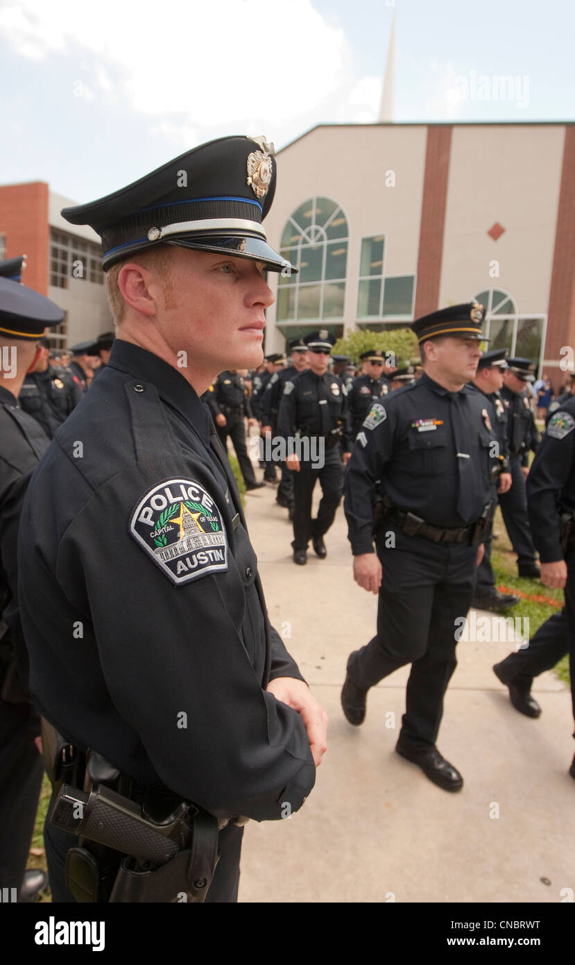 Crowd of officers in uniform attended funeral for Austin Police Officer  who was killed in the line of duty in a - Stock Image