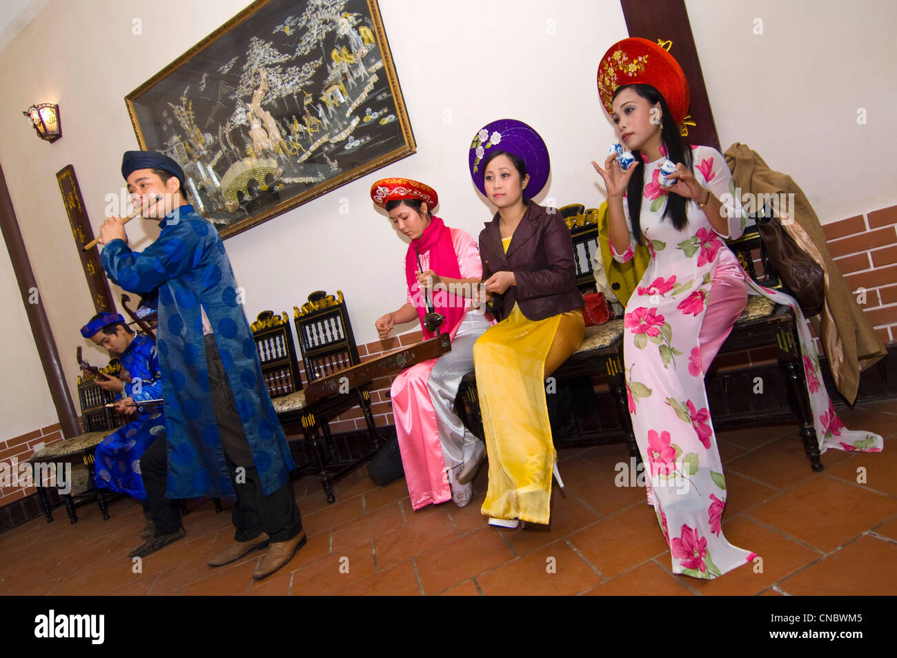 Horizontal view of a traditional Vietnamese troupe of musicians playing and singing traditional folklore songs in - Stock Image