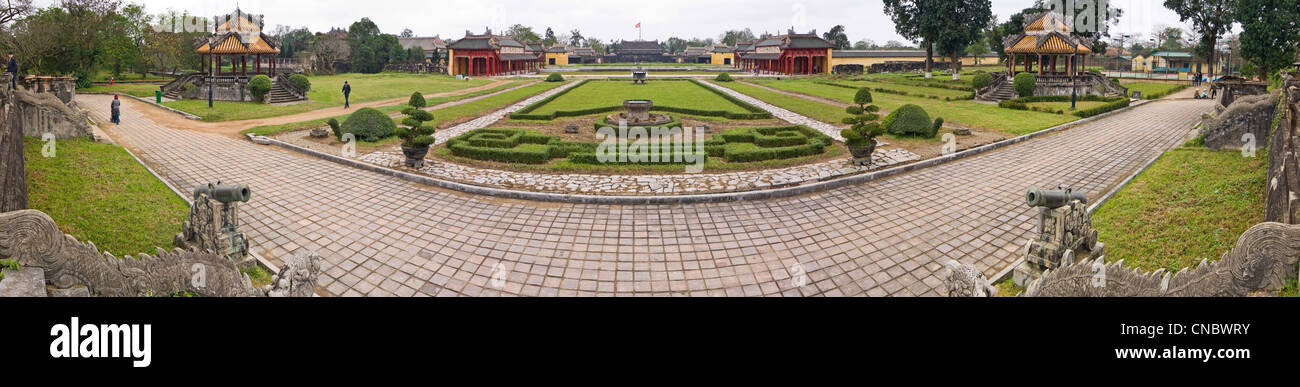 Horizontal panoramic view of the gardens at the Imperial Citadel with Thai Hoa palace and Flag tower in the background Stock Photo