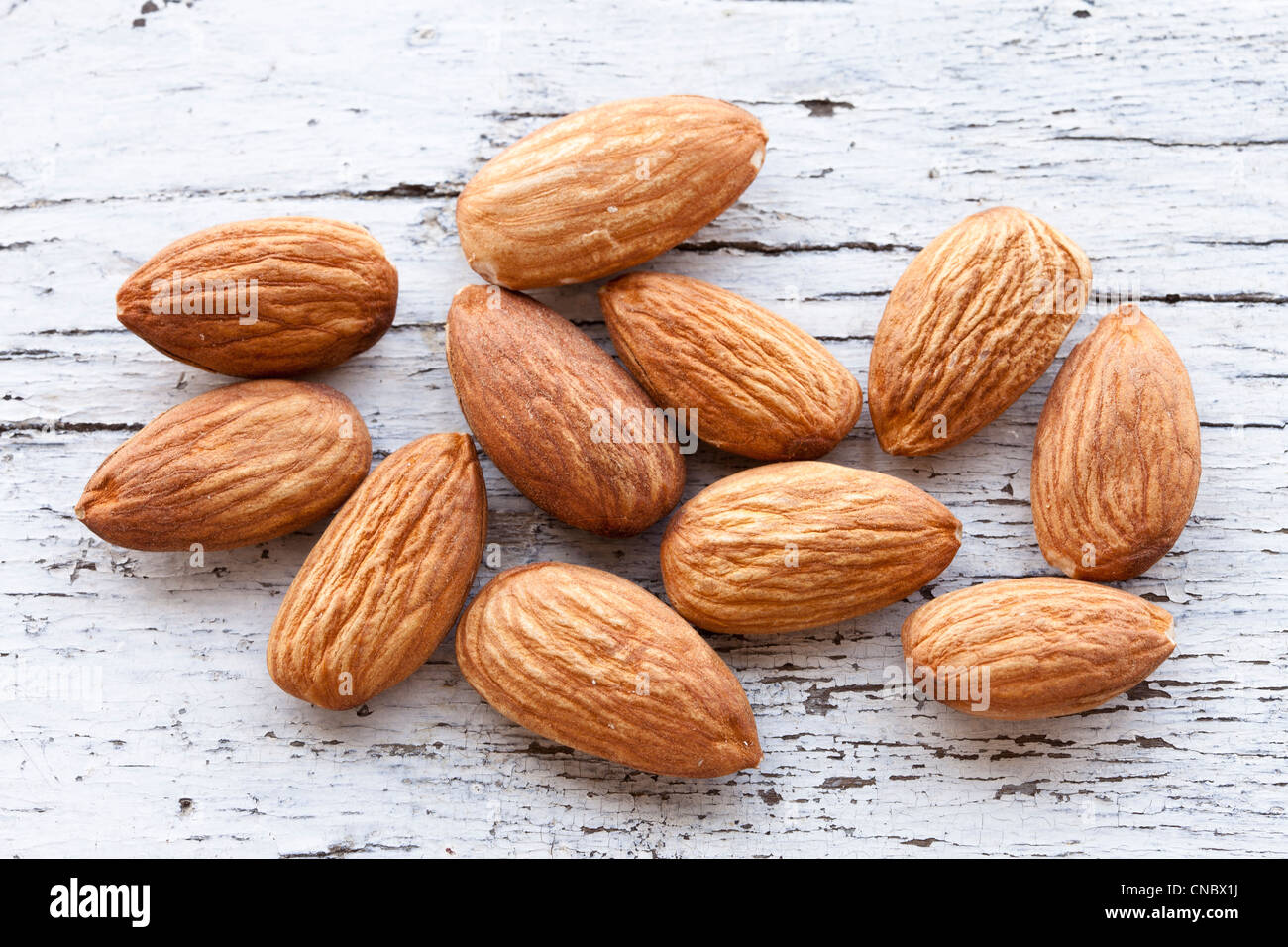 Almonds sitting on a counter top - Stock Image