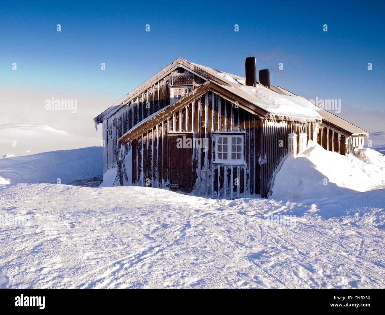 snow covered Norwegian mountain hut operated by the DNT, the Norwegian trekking association - Stock Image
