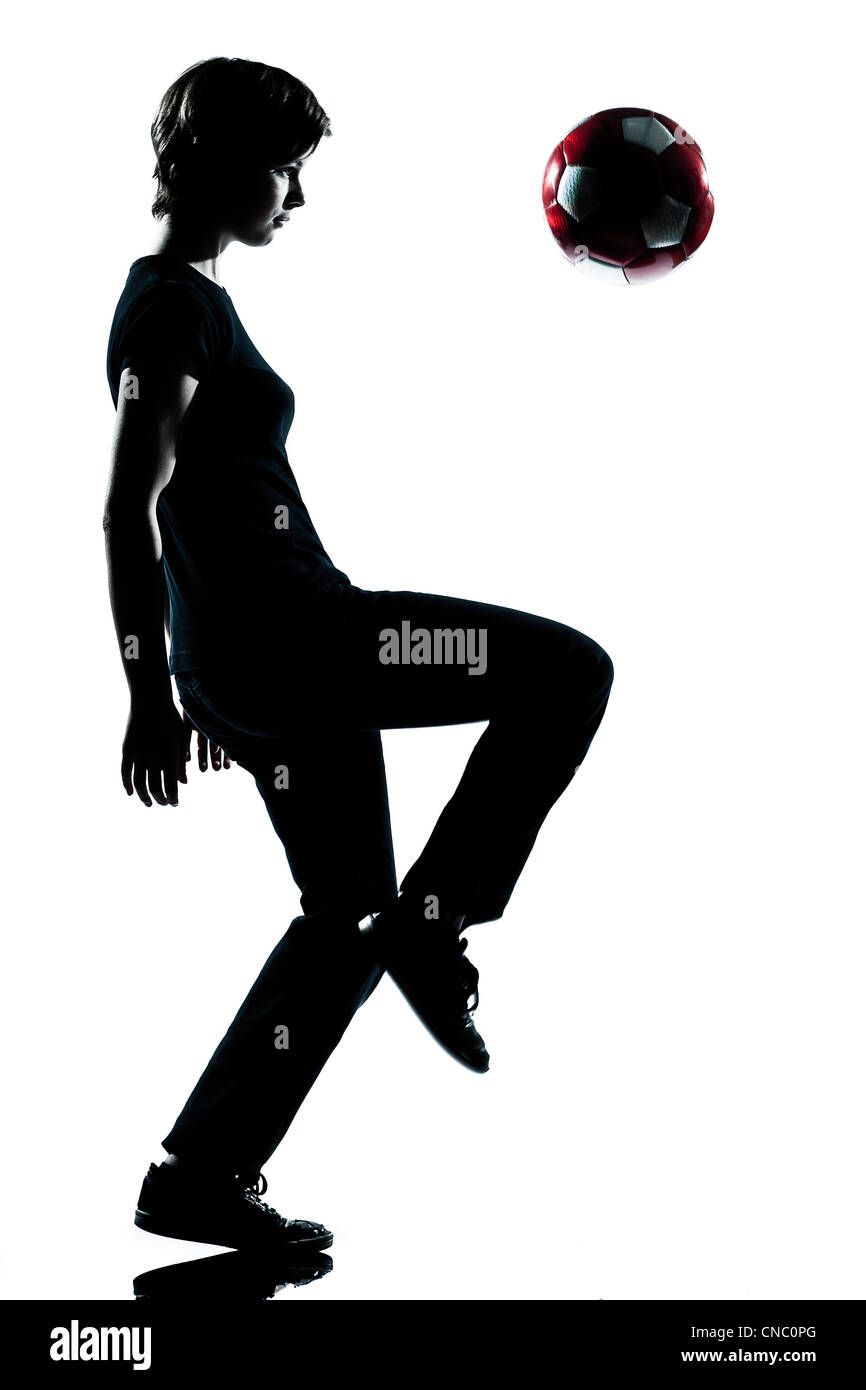 one caucasian young teenager silhouette boy   juggling soccer football full length in studio cut out isolated on - Stock Image