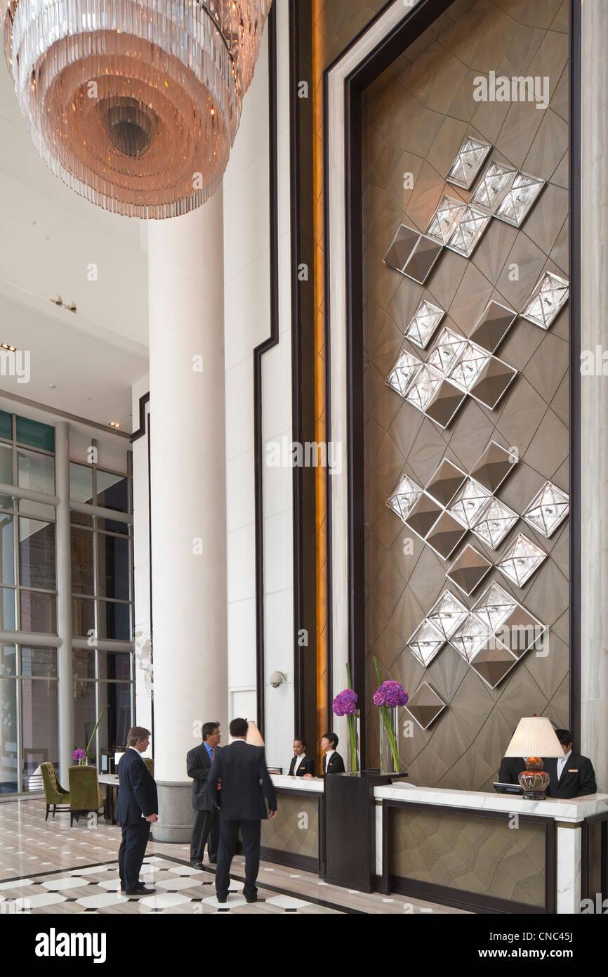 Singapore, Marina Bay, Fullerton Bay Hotel opened in 2010, lobby made by Hong Kong based designer Andre Fu - Stock Image