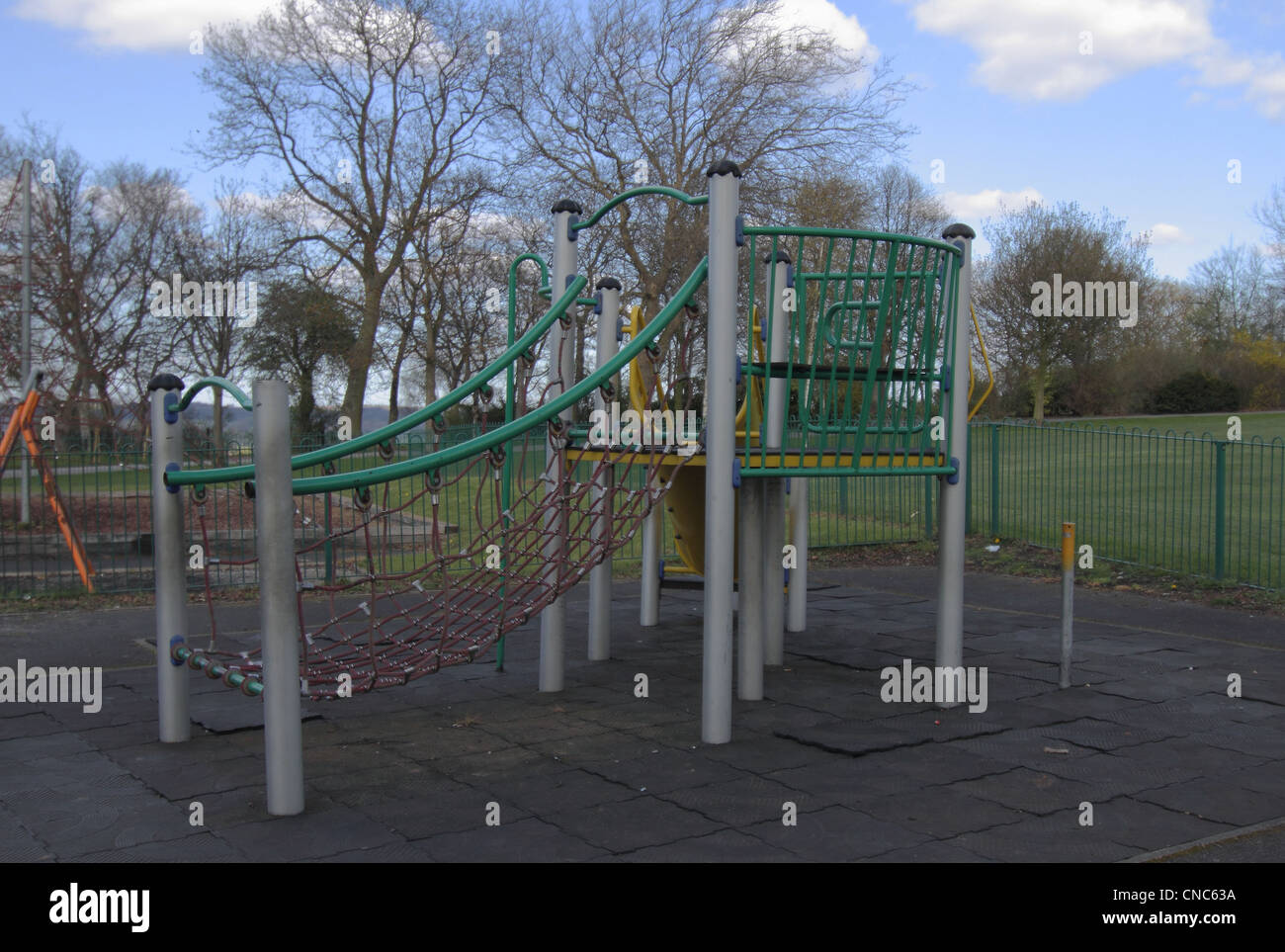 childrens play area in park swings see-saw slide - Stock Image