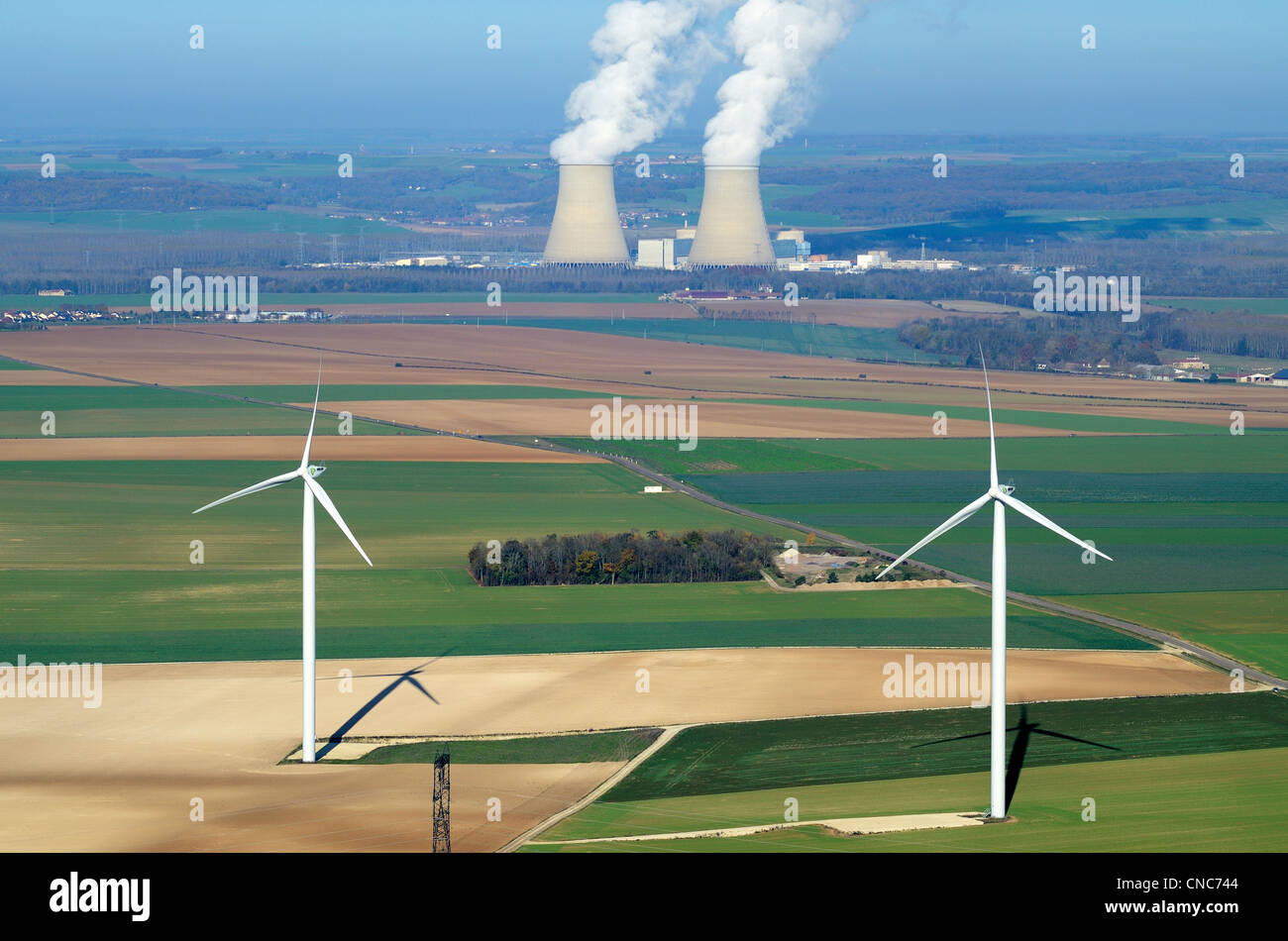 France, Aube, Nogent-sur-Seine, the nuclear power plant of Nogent-sur-Seine is the nearest to Paris, with wind turbines - Stock Image