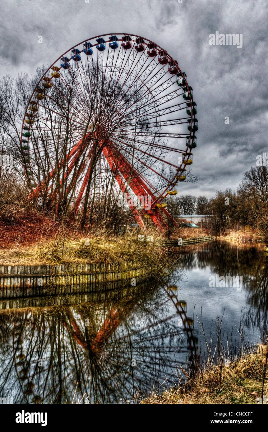 A big wheel at an abandoned funfair in Treptower Park (aka Spreepark) in ex East Berlin Stock Photo