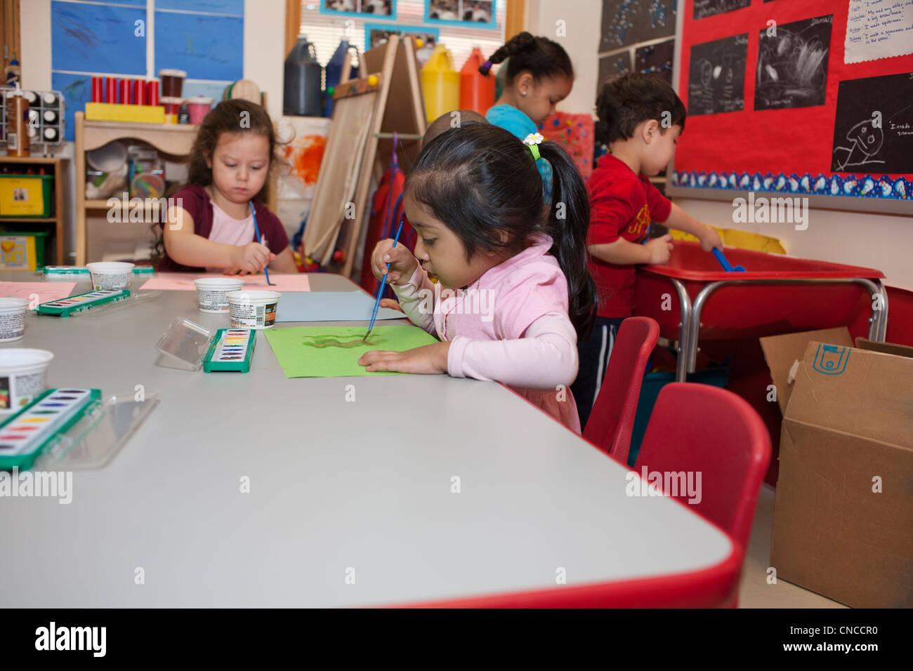Preschool children in classroom Stock Photo