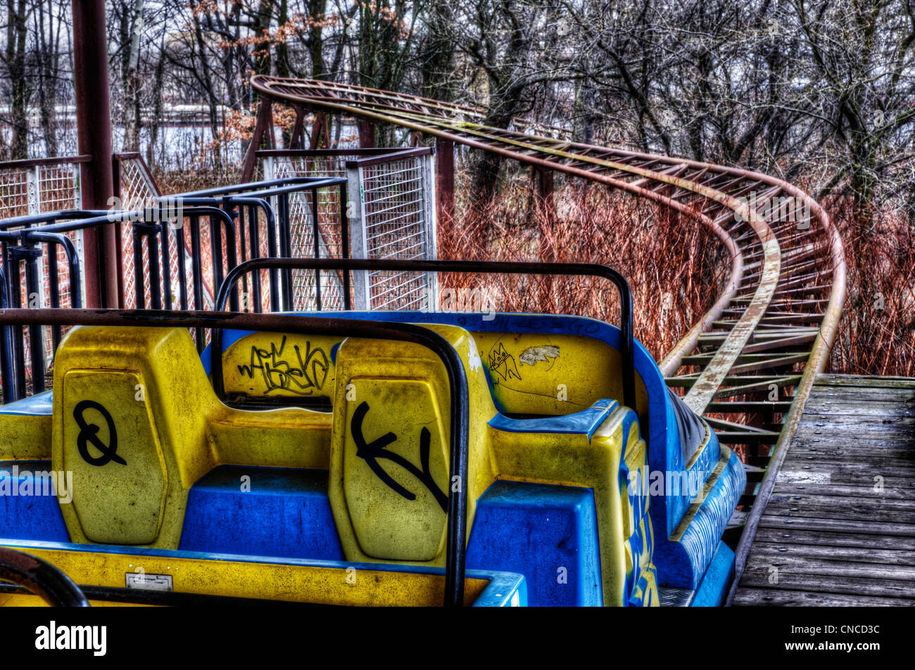An abandoned roller coaster at the funfair in Treptower Park (aka Spreepark) in ex East Berlin - Stock Image
