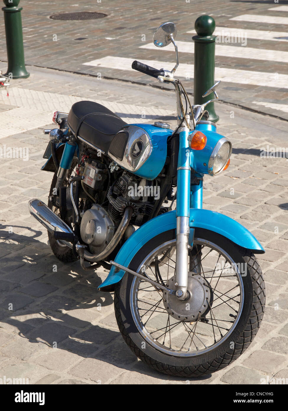 Classic sixties Honda twin-cylinder motorcycle parked on the sidewalk in Brussels, Belgium - Stock Image