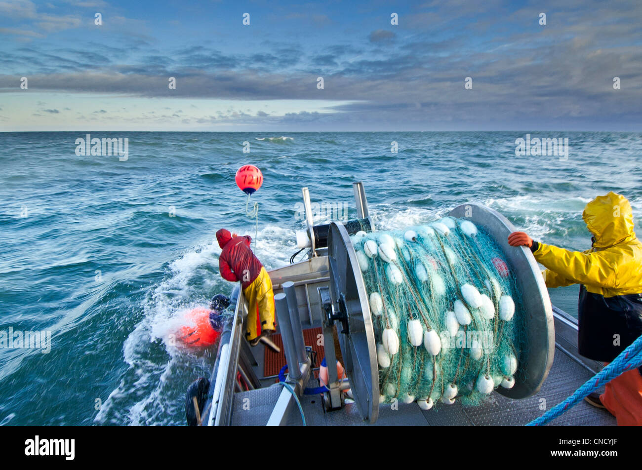 The crew casts out the first set of a gillnet in Ugashik Bay, Bristol Bay region, Southwest Alaska, Summer Stock Photo