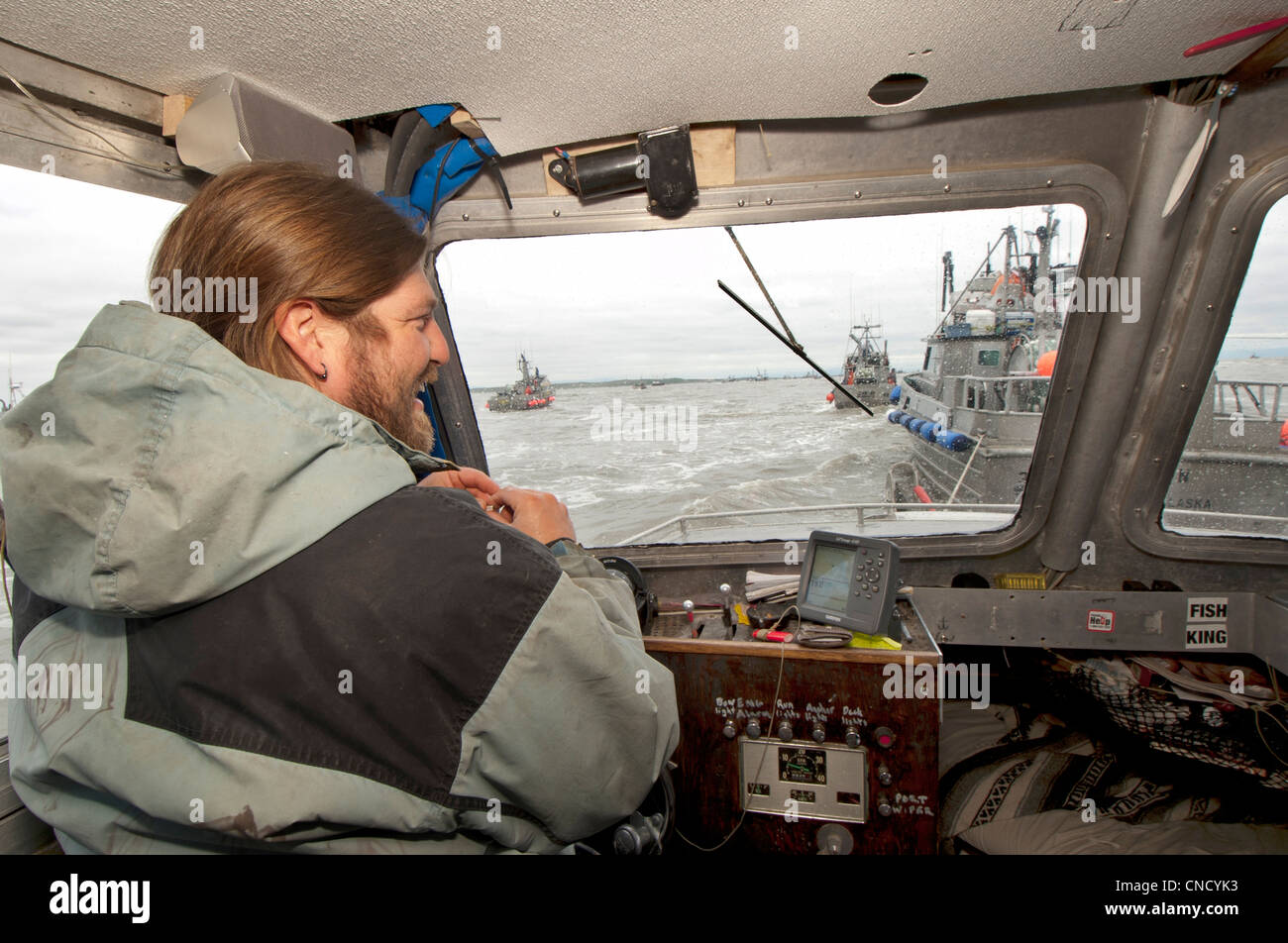 Skipper jokes with his crew on while waiting to deliver the morning's catch in Ugashik Bay, Bristol Bay region, - Stock Image