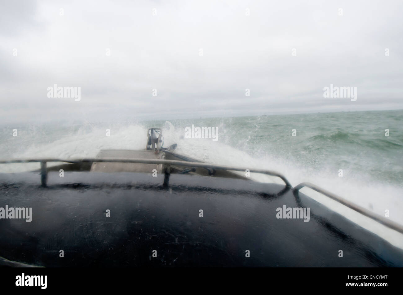 View from the cabin of waves crashing over the bow of a drift net boat in Bristol Bay near Naknek, Soutwest Alaska, Stock Photo