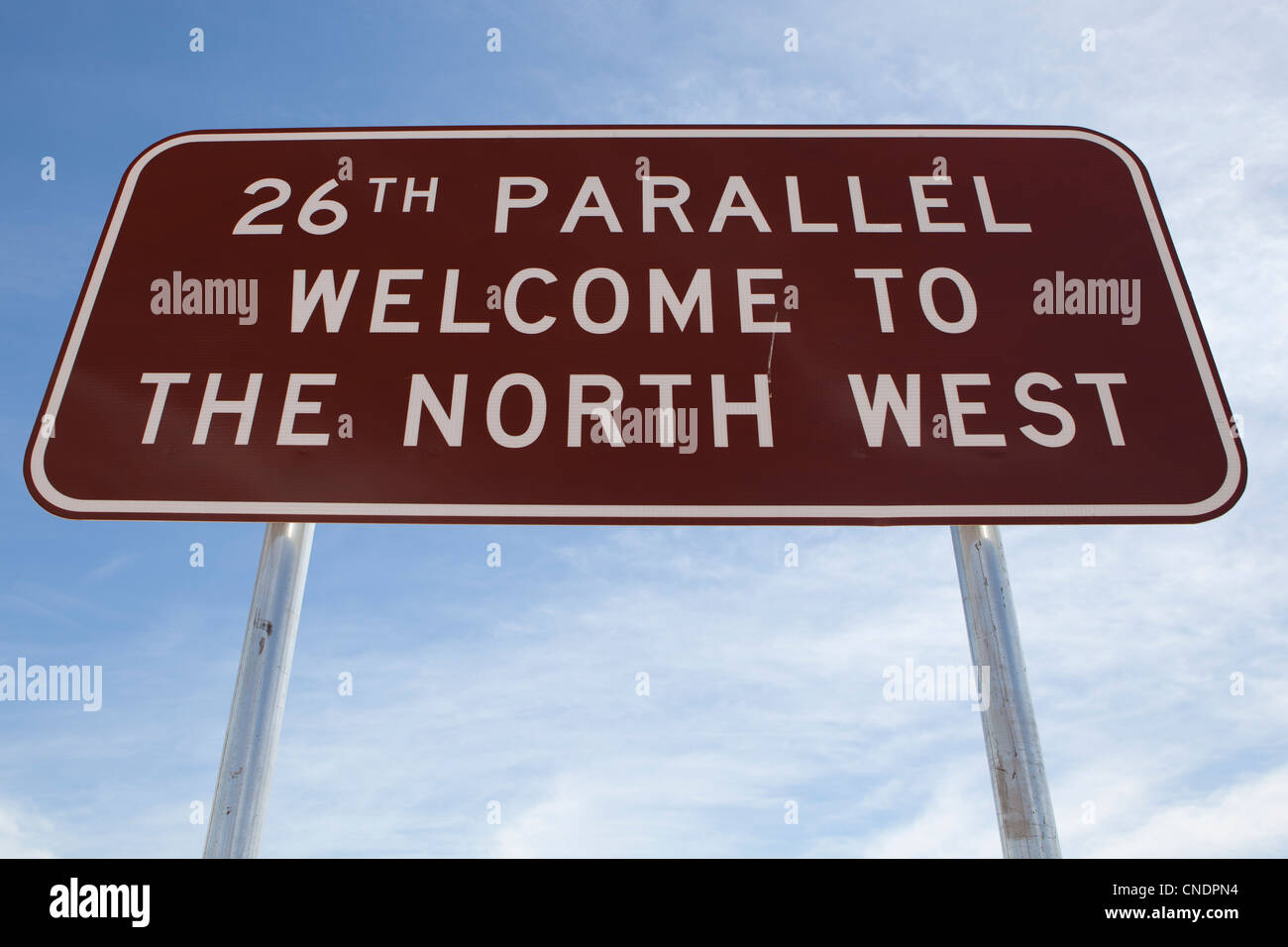 Signpost telling people they are passing the 26th Parallel in Western Australia. - Stock Image